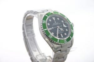 rolex green submariner anniversary display