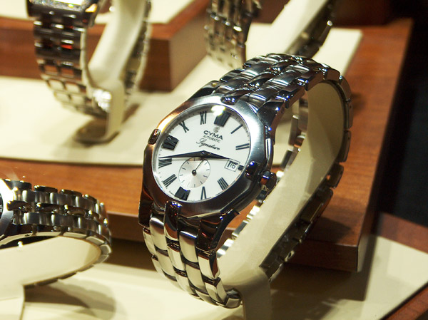 cyma signature stainless steel wristwatch